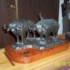 Two Cape buffalo bulls, an example of two sculptures in combination for a more powerful piece.  $2,850.00.