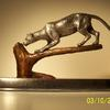 Snow leopard cast in pure silver Bronze$1,350.00.  Silver call for quote.